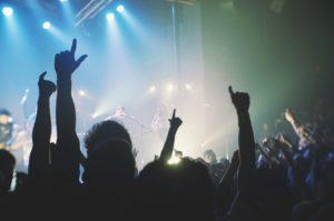 live concert people raising arms