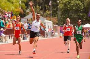 running race special olympics man raising arm